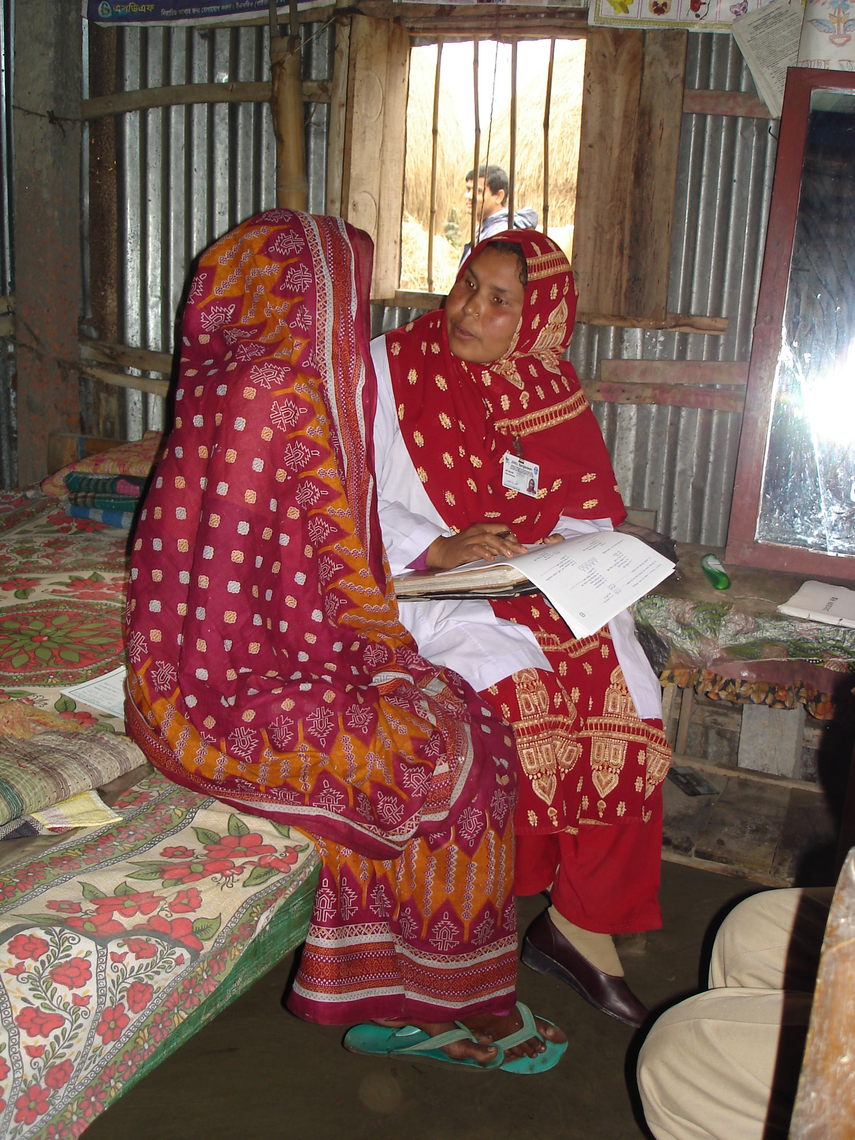 Field interviewer Lipi Begum, of the JiVitA Project in rural Gaibandha, Bangladesh, conducts an enrollment interview with a consented study participant.
