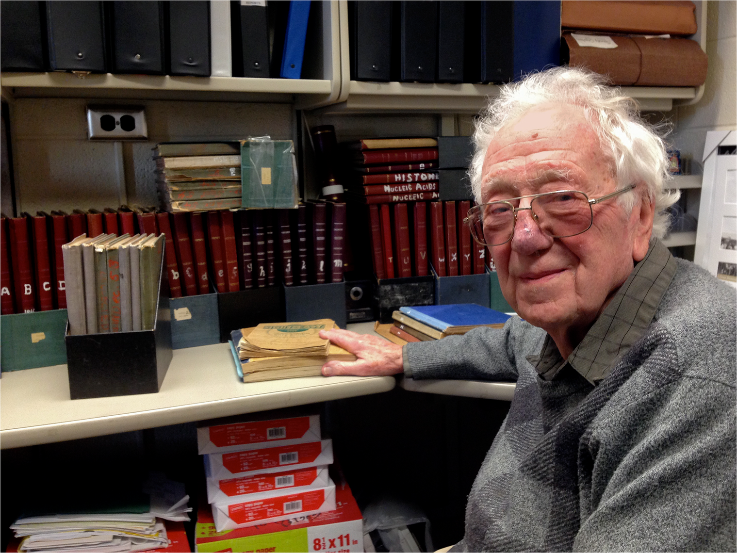 Oliver Smithies with a lifetime of notebooks.