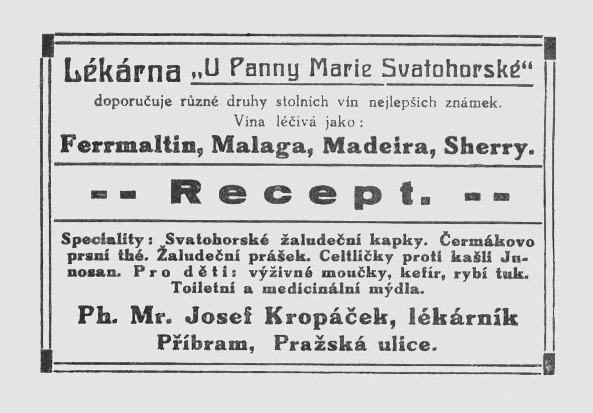 """Receptní obálka lékárny """"U Panny Marie Svatohorské"""" PhMr. Josefa Kropáčka v Příbrami. Doporučuje stolní i léčivá vína, své domácí speciality, přípravky pro děti, toaletní i léčivá mýdla; po roce 1914, ČFM"""
