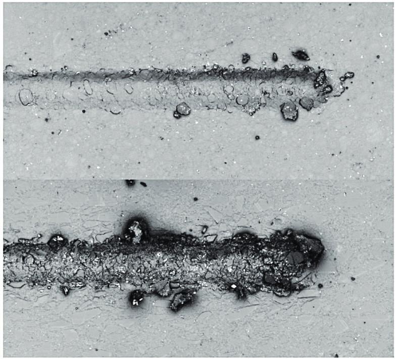 CLSM obraz vrypů flow kompozitního (nahoře) a pastovitého nanohybridního kompozitního materiálu (dole)